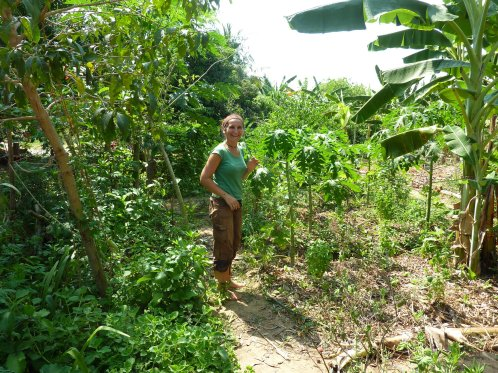 Lovely Aline in her garden  at Solitude Farm, Auroville