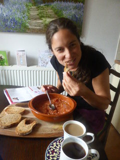 Jane nibbling on a Tostada con Tomate - One of the recipes in our new cookbook - Peace and Parsnips