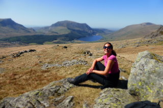 Jane at the base of Snowdon with Mynydd Mawr in the background