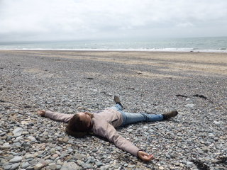 Sunbathing today on Dinas Dinlle, many miles away from a Radio interview!