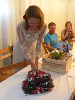 Laura cutting Mums massive Cloud Forest Chocolate Cake