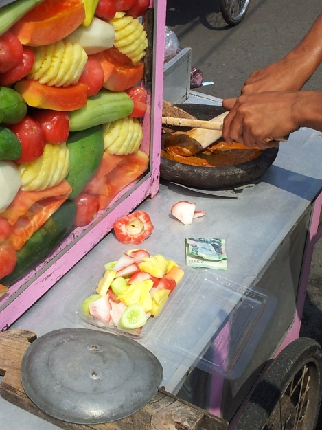 Breakfast. Fruit salad with things like cactus fruit and a sauce made from cane sugar and chilli. Yogyakarta, Java