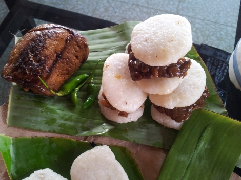 One of the finest things we ate. Sticky coconut rice, made into buns, and marinaded tempeh (in cane sugar and kecap manis) for the burger. A local street food speciality in a village above Yogyakarta, Java. PS - Thats a massive hunk of marinade tofu. Delicious.