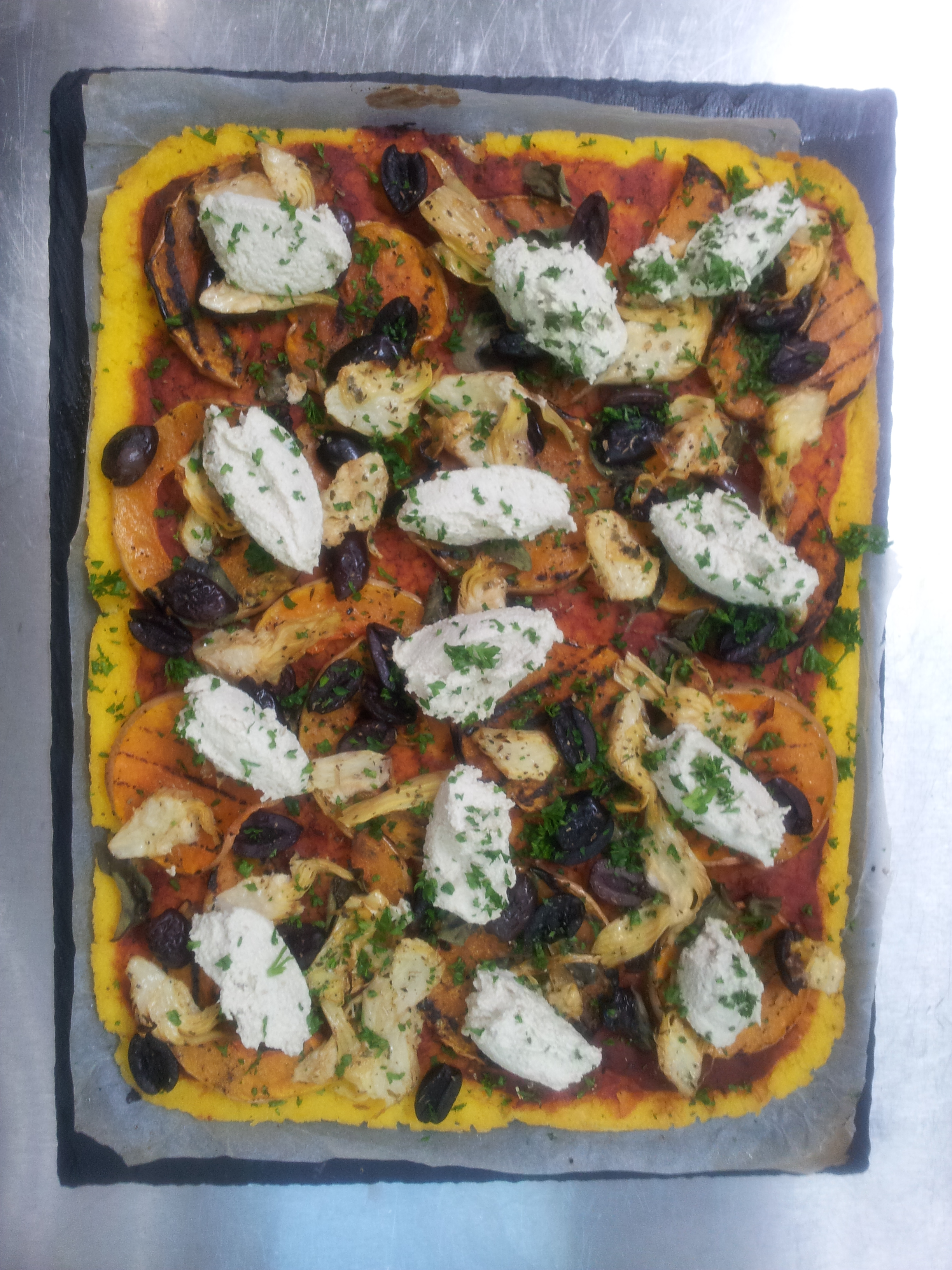 Polenta Pizza with loads of goodies....sunflower cream cheese, artichokes, grilled squash and fennel